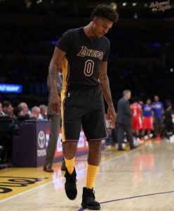 Swaggy P rocking the Black Yeezy 750 on court