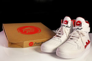 Pie Top sneakers next to a Pizza Hut Box