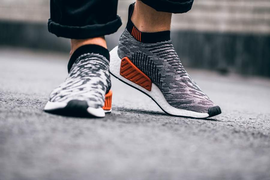 """64ec5322b0df Adidas is releasing a new batch of the updated NMD City Sock. The CS2  Primeknit features """"glitch camo"""" colorways including a wonder pink version  for women."""