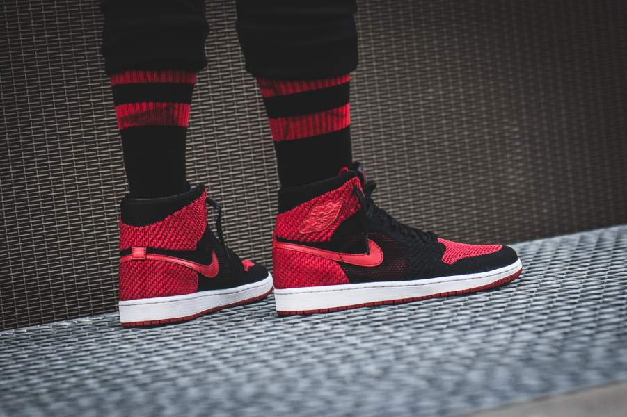 "333f3ee196fceb The latest Nike Air Jordan 1 reboot is wrapped in Flyknit. Donning the  classic ""banned"" colorway for it s premier"