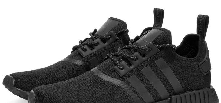 Adidas x Pharrell Williams Triple Black NMD on sale for $102